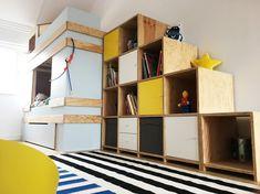 Kinderhoogslaper met kasttrap ingevuld met kallax elementen van IKEA