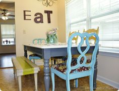Love the grey and white for the table, and I LOVE the bench and mismatched chairs. This would be so much fun in my kitchen!