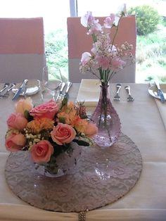 Elegant vintage floral centrepiece by www.newminsterfunctiondesign.com