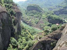 """The Wu Yi mountain area of South China. Teas from this area are known as Rou Gui or """"Rock Teas"""" because the tea plants are scattered in little wild patches on the sides of steep mountainsides among the rocky cliffs."""