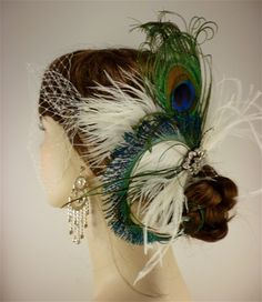 the height of gorgeous much-to-muchery. peacock and russian net veil