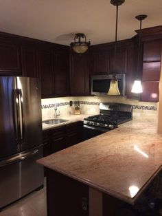 Kitchen Cabinet Kings CHERRY GLAZE CABINETS   Material- Solid birch   Style - Full overlay, butt door   Wall & Base - Raised square   These cabinets are factory assembled by our experienced staff to ensure a high quality assembled cabinet, every time.