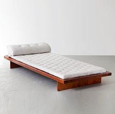 R gallery - Daybed in jacaranda with upholstered cushion and headrest. Designed by Joaquim Tenreiro, Brazil, 1960s.