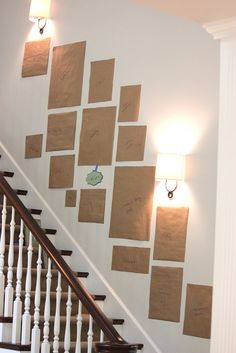 How to Arrange a Picture Display    Use   craft paper to trace and cutout each item to be hung. Use painters tape to put   them up on the wall which allows you to move them around easily.  Also label   each paper square to get just the right mix of photos and art   pieces.