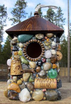 Birdhouse with Wine Corks and Rocks-a very fun way to use your wine corks & fun treasures picked up from your travels.: