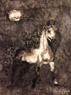 Needle felted painting of a horse in the moonlight.