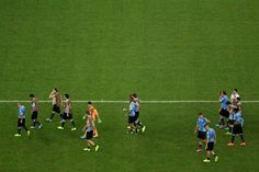 Uruguay players look dejected after being defeated by Colombia in the...