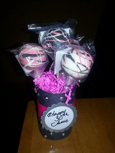 Cake pops centerpiece for my sister's 30th Birthday!  Huge hit.  Made out of soup cans, construction paper, Styrofoam, ribbon and bling jewels. Easy and fun for bridal showers, baby showers, birthdays, ect.  Www.cakepopsbydesign.info