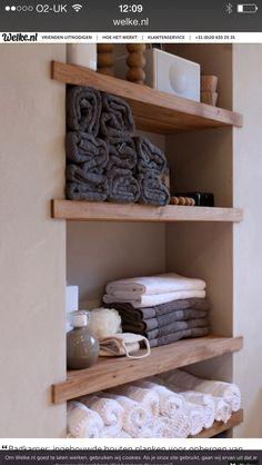 Wooden shelves in beton cire