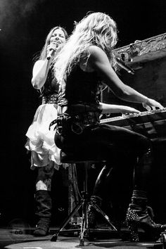 Lzzy Hale of Halestorm (at the piano) and  Amy Lee of Evanescence