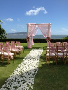 The Kahala Koko Head Wedding...PInk arbor with white flower aisle.