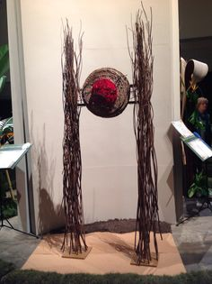 RIFGC Standard Flower Show 2015 Class Title: Big Safari Creative Floor Design Awarded: Honorable Mention Comment: Texture conveys sense of Africa. Eyes are drawn to central grouping of red impeding rhythm. Gray, designer Ashland Garden Club of NH Garden Club, Arte Floral, Flower Show, Floor Design, Ikebana, Design Awards, Hanging Chair, Plant Hanger, Creative Design