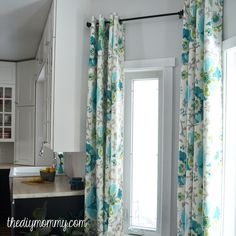 How to Sew DIY Grommet Topped Drapes - LOVE this fabric, too!