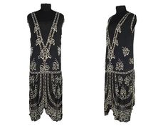 1920s Tubular dress with two semi-circular flaps, decorated with a white beads and metallic thread, forming large floral patterns.