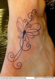 Swirly butterfly tattoo on foot