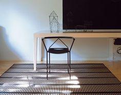 Cut Stripe Paper Yarn Carper designed by Ritva Puotila.  Available at SUITE New York.