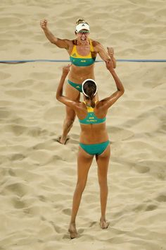 RIO DE JANEIRO, BRAZIL - AUGUST 08: Taliqua Clancy and Louise Bawden of Australia celebrate during the Women's Beach Volleyball preliminary round Pool F match against Olaya Perez Pazo and Norisbeth Agudo of Venezuela on Day 3 of the Rio 2016 Olympic Games at the Beach Volleyball Arena on August 8, 2016 in Rio de Janeiro, Brazil. (Photo by Ezra Shaw/Getty Images)