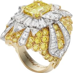 Van Cleef & Arpels ring in white and yellow gold with a central Vivid yellow emerald-cut diamond, white trillion-cut diamonds and round and fancy-cut yellow diamonds.