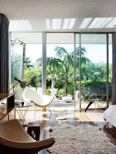 You can't beat floor-to-ceiling windows leading out to an inviting green space.