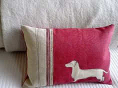 hand printed and stitched muted red daschund cushion