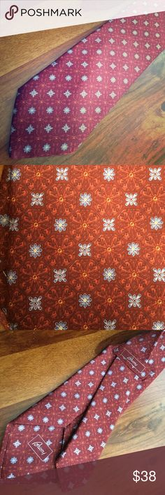 Silk Brioni Tie Gorgeous silk tie in like new condition. Burgundy, gold and powder blue. Brioni Accessories Ties