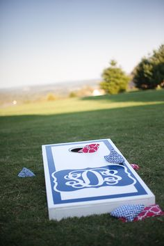 Adorable custom monogrammed cornhole set for the reception. It just wouldn't be a #Southern #wedding without cornhole! Photography By / http://mellowyellowphotography.com