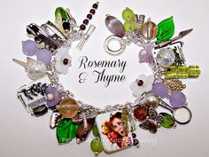 ROSEMARY & THYME Mystery Charm Bracelet  Fans of the British TV cozy mystery series set in beautiful English and European gardens, Rosemary & Thyme, starred Felicity Kendal and Pam Ferris as gardening detectives Rosemary Boxer and Laura Thyme. Brought together by a sudden death, they discover their shared love of gardening and knack for detection. This stunning bracelet pays homage to this engaging duo.