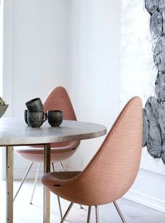 Drop chair by Arne Jacobsen and PK54 table by Poul Kjærholm from Fritz Hansen
