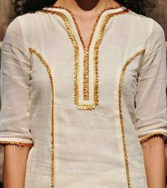 Ivory-Mustard Gota Embellished Cotton Kurta-Lehenga & Dupatta Set of ivory and gold Sharara set has an old world charm with its delicate and lightweight finish in soft mulmul fabric. Its well tailored and finely Salwar Neck Designs, Kurta Neck Design, Neck Designs For Suits, Sleeves Designs For Dresses, Kurta Designs Women, Dress Neck Designs, Blouse Designs, Stylish Dresses For Girls, Stylish Dress Designs