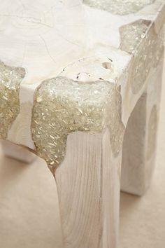Ummm, LOVE!  What a great way to fill in cracks/crevices in repurposed furniture!  Epoxy and metal/large glitter/stone...the options are endless!  Way to go Anthropologie, thanks for the brilliance!