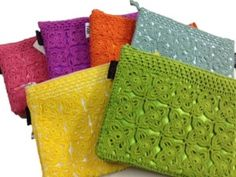 Lace Cosmetic Bag: Hand-crocheted cotton lace cosmetic bags are lined with satin to safe-keep jewelry, cosmetics, eyeglasses, or to use as a designer coin purse or clutch purse. They are available in a beautiful assortment of colors. Your purchase of this handmade product benefits women in impoverished areas of south India by providing them a fair wage. Hand wash only and dry flat. 100% cotton lace with satin lining. Fair Trade. $12.
