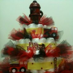 Fire Fighter Diaper Cake- I wouldnt use the colors or theme, but i like the idea of using tool! sp?