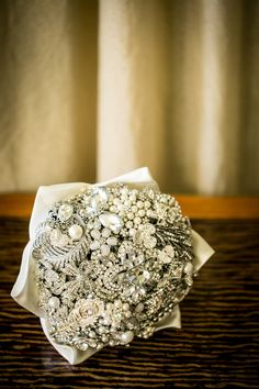 LOVE Brooch Bouquets || See the wedding on Style Me Pretty: http://www.StyleMePretty.com/destination-weddings/2014/02/12/shangri-la-fijian-resort-and-spa-wedding/ Malia Johnson Photography