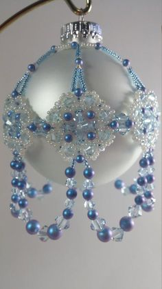 Beaded Christmas ornament made with Swarovski iridescent light blue pearls, Swarovski light azore and crystal ab crystals, size 11 and 15 seed beads.
