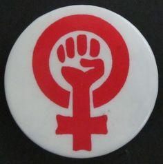 [Símbol feminista amb puny].