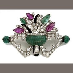 An Art Deco diamond, gem-set and enamel brooch, circa Centring a carved emerald vase containing a floral motif of carved emerald and ruby leaves, accented by an openwork geometric base of old European and baguette-cut diamonds, mounted in platinum. Bijoux Art Deco, Art Deco Jewelry, Fine Jewelry, Jewelry Design, Antique Brooches, Antique Jewelry, Vintage Jewelry, Art Nouveau, Art Deco Diamond