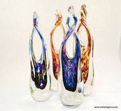 Unity in glass ceremony.  During ceremony mix glass crystals and then send the mix back to the artist who will create a one of a kind glass sculpture keepsake!