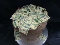 Money Cake - This cake is a double layer pound cake, double layer chocolate cake, & double layer vanilla cake, with buttercream filling covered in fondant. It was for a teenage boy who only wanted money for his birthday! TFL!