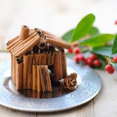 Learn how easy it is to do this cinnamon house. All you'll need are cinnamon sticks and a glue gun.