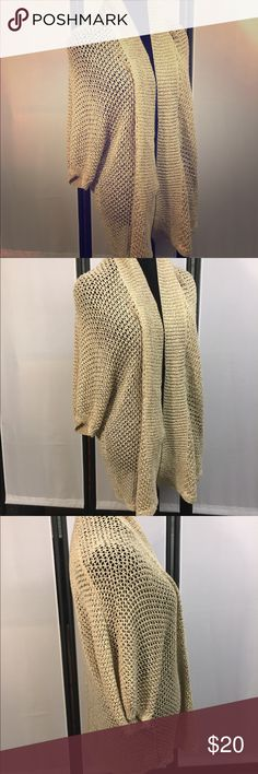 WDNY Woman Gold Open Weave Cardigan Duster. SZ 3X WDNY Woman Gold Open Weave Cardigan Duster. SZ 3X in EUC. This lovely open front Duster Cardigan drapes beautifully. The color is Gold and the thread has some gold metallic accents weaved in. Very lovely! WD.NY Sweaters Cardigans