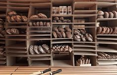 Having adjustable shelves for your bread to sit on. Plus, it adds an artistic flare to the interior design of the shop!