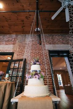 "BG brides, not since The Royal Wedding has a celebrity's wedding cake received as much fanfare as Kaley Cuoco's! And with good reason — The Butter End Cakery fulfilled the Big Bang Theory star's wish for something ""over the top"" with their upside-down chandelier cake. Thanks to custom rigging, sandbags, and clever engineering, the blinged-out confection miraculously stayed in place for her entire reception on New Year's Eve. Unable to get these magical (albeit outrageous) images out of my…"