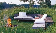 This in ground fire pit and built-in seating area are sunken into the surrounding meadow, making a very intimate setting.