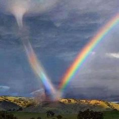 Tornado sucks up rainbow.