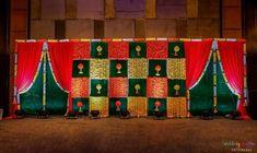 Red drapes with marigold tassles for colourful backdrop. Desi Wedding Decor, Wedding Hall Decorations, Marriage Decoration, Backdrop Decorations, Backdrops, Indian Wedding Stage, Wedding Stage Backdrop, Wedding Mandap, Cradle Decoration