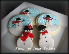 The snow, eyes, buttons and nose are royal icing - the rest is fondant. Adapted from some of the many snowman scene cookies on CC and elsewhere.