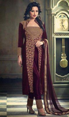 Let the stylish fashionista lying deep in your soul awaken with this maroon color embroidered net and velvet pant style suit. This attire is displaying some really mesmerizing and inventive patterns embroidered with lace and resham work.  #straightcutdresses #westernstylesuit #latestembroidereddress