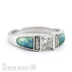 This nontraditional opal engagement ring is handmade in the United States. Browse our selection of one-of-a-kind wedding rings to find the one for you. | The Alchemy Bench #bridaltransformed