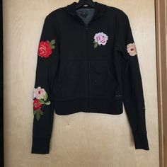 LUCKY BRAND COLLARED SWEATERSHIRT Beautiful and Cozy Black Lucky Brand sweatshirt with Flower Embroidery as pictured; lightly used; Full Zipper in Front; Two pockets on each side in front Lucky Brand Tops Sweatshirts & Hoodies
