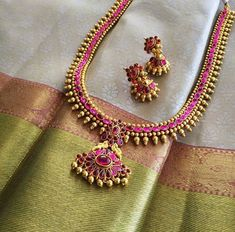 Silver gray kanchipuram silk saree with dusty rose and pale green gold border paired with temple haram necklace and jhumkas Latest Necklace Design, Necklace Designs, Saree Jewellery, Temple Jewellery, Long Pearl Necklaces, Gold Necklace, Gold Jewellery Design, Gold Jewelry, Gold Bangles